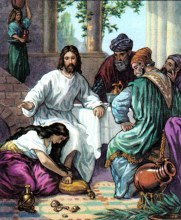 A woman washes the feet of Jesus